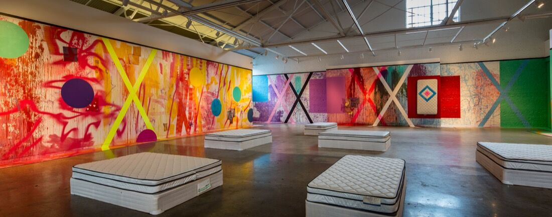 """Installation view of Sarah Cain's """"The Imaginary Architecture of Love."""" Image courtesy ofCAM Raleigh and Anthony Meier Fine Arts."""