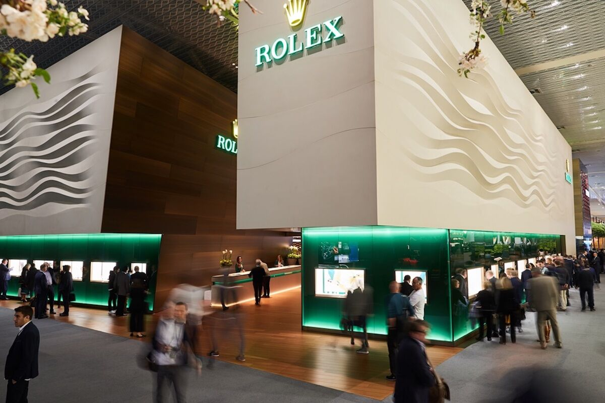 Visitors pass the Rolex booth at a past edition of Baselworld. Photo © MCH Group.