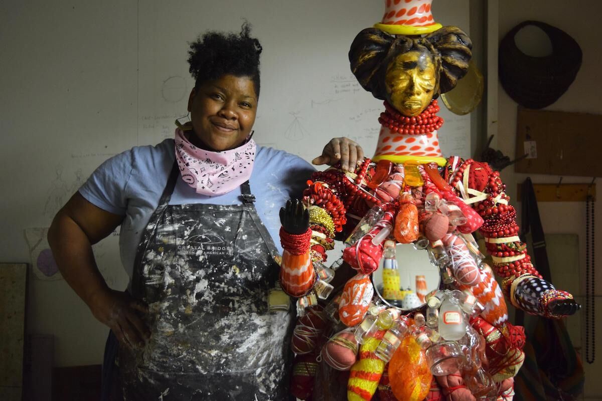 Vanessa German at Wheaton Arts and Cultural Center, Millville, New Jersey with her sculpture we are the animals are us. Photo courtesy Wheaton Arts and Cultural Center.