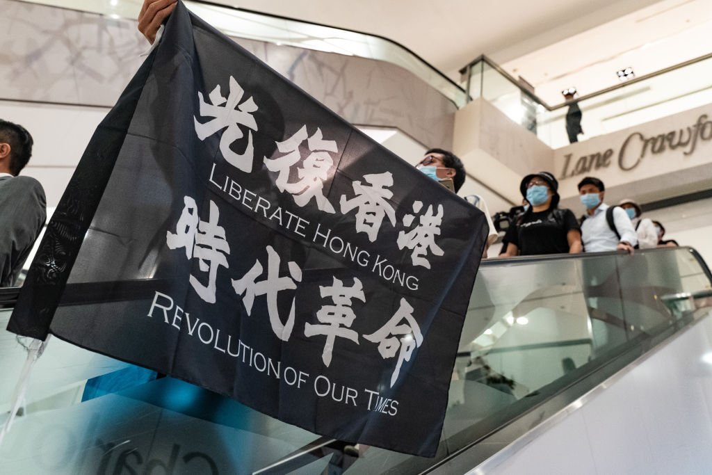Pro-democracy demonstrators protesting new national security measures being imposed by Beijing on Hong Kong. Photo by Anthony Kwan/Getty Images.
