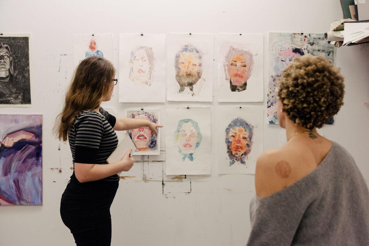 MFA student Liza Sokolovskaya and Amy Sherald during a studio critique at New York Academy of Art. Photo by Daniel Dorsa for Artsy.