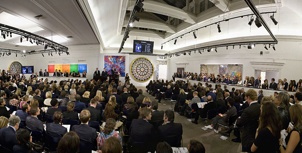 """Auction of work by Damien Hirst at the Sotheby's sale """"Beautiful Inside My Head Forever,"""" 2008. Courtesy of Sotheby's."""