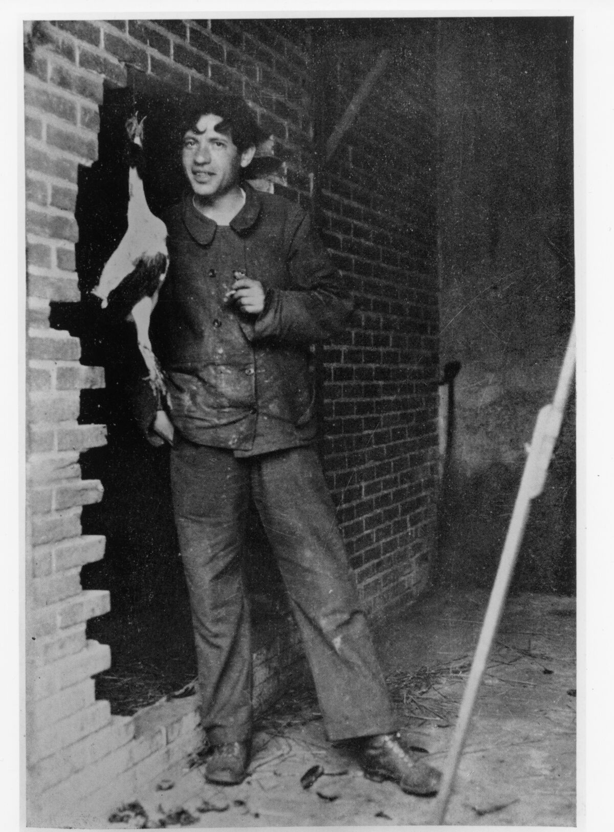 Chaim Soutine with a chicken, hanging in front of a broken brick wall, Le Blanc, western France (Indre), 1927. Courtesy of the Kluver/Martin Archive and The Jewish Museum.