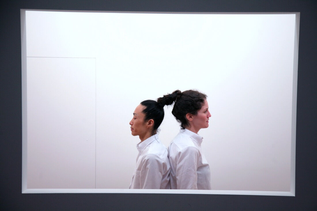Relation in Time, reperformed continuously in shifts throughout the exhibition Marina Abramović: The Artist Is Present at MoMA, March 14-May 31, 2010. Pictured in this image: Yozmit, Lydia Brawner (left to right). Marina Abramović and Ulay originally performed Relation in Time in 1977 for 17 hours at Studio G7, Bologna. Photo by Scott Rudd.