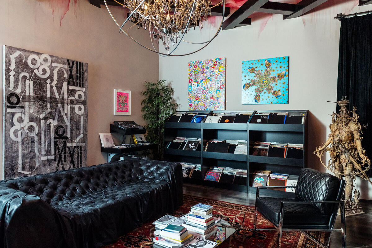 Aoki's obsession with collecting started with second-hand records and expanded to vinyl toys and art. His library features his first-ever art purchase, a painting by L.A.–based street artist RETNA, as well as works by Takashi Murakami and sculptor Kris Kuksi. Photo by Brian Guido for Artsy.