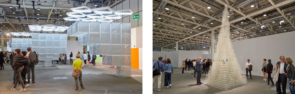 Left:Installation view of Haegue Yang,Sol LeWitt Upside Down - Structure with Three Towers, Expanded 23 Times, Split in Three, 2015, presented by Kukje Gallery and Tina Kim Gallery at Art Basel Unlimited, 2016; Right: Installation view of Sol LeWitt, Irregular Tower, 1999, presented by Alfonso Artiaco Gallery at Art Basel Unlimited, 2016. Photos by Benjamin Westoby for Artsy.