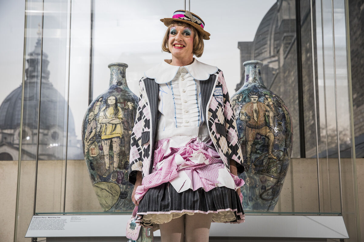 Grayson Perry next to his Matching Pair (2017) ceramic vases. Photo © Tristan Fewings/Getty Images for the V&A.