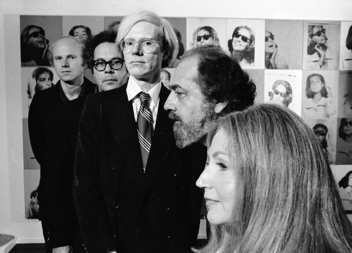 Andy Warhol photographed with art collectors Ethel and Robert Scull, sculptor George Segal, and painter James Rosenquist at the Scull's residence in 1973. (Photo by Jack Mitchell/Getty Images)