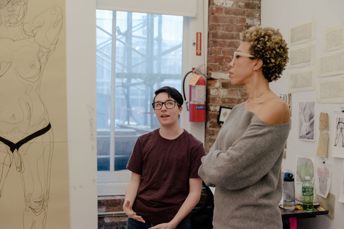 MFA student Lou Eberhard and Amy Sherald during a studio critique at New York Academy of Art. Photo by Daniel Dorsa for Artsy.