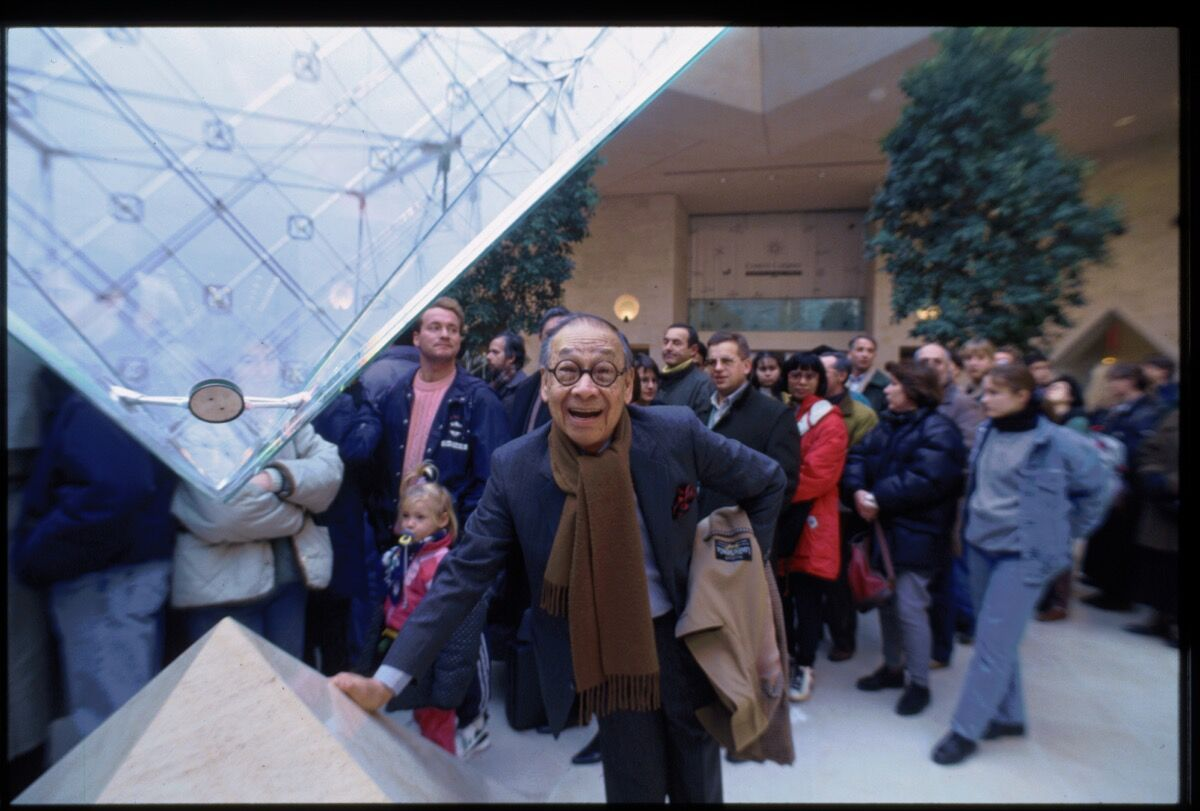 Architect I.M. Pei stands beside the tip of the Louvre's inverted pyramid in the Galleries of the Carrousel. Photo by Owen Franken/Corbis via Getty Images.