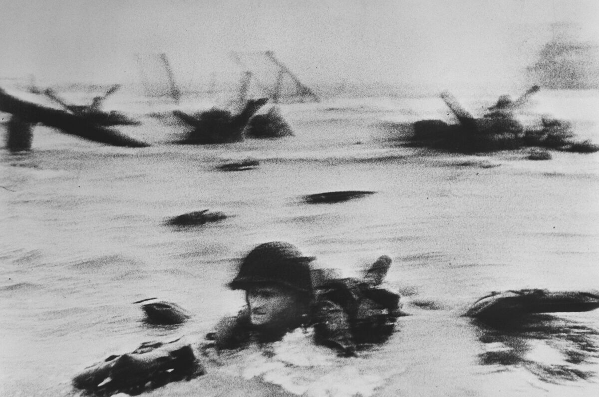 Robert Capa US troops assault Omaha Beach during the D-Day landings (first assault), 1944. Courtesy of Magnum Photos.