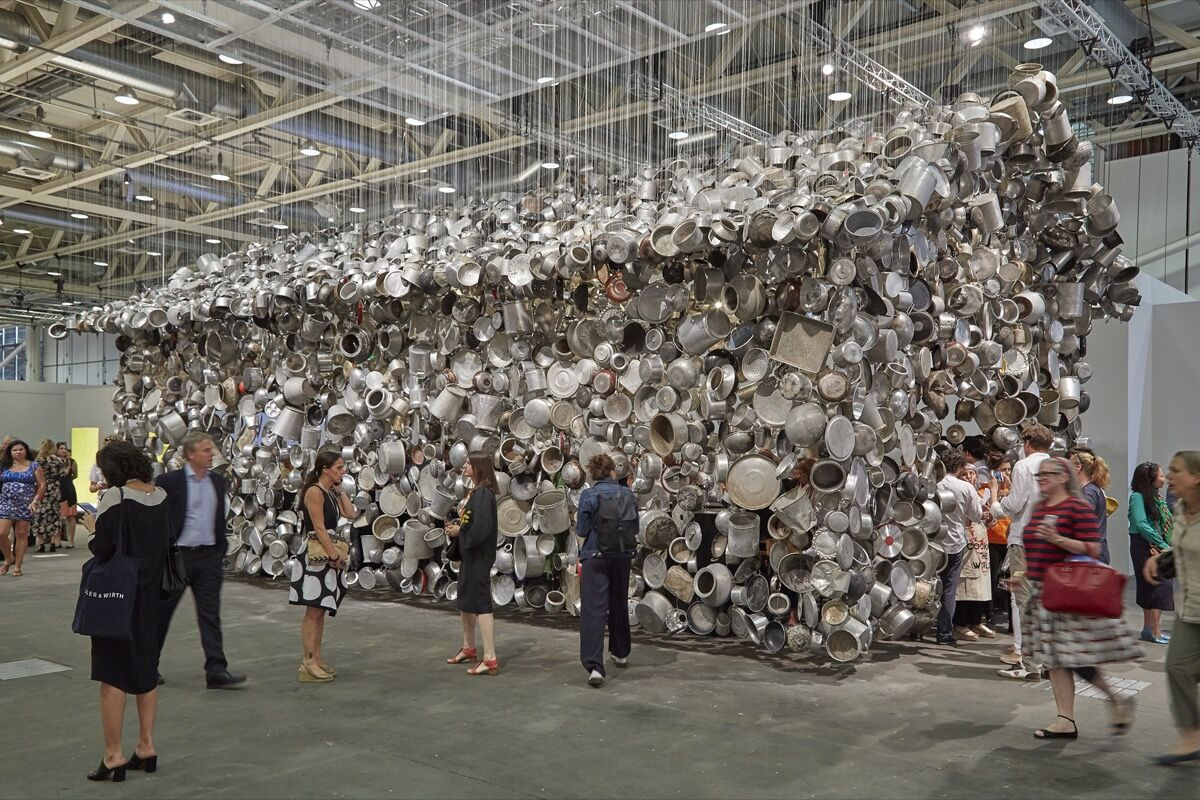 Installation view of Subodh Gupta, Cooking the World, 2017, presented by Continua and Hauser & Wirth at Art Basel Unlimited, 2017. Photo by Benjamin Westoby for Artsy.