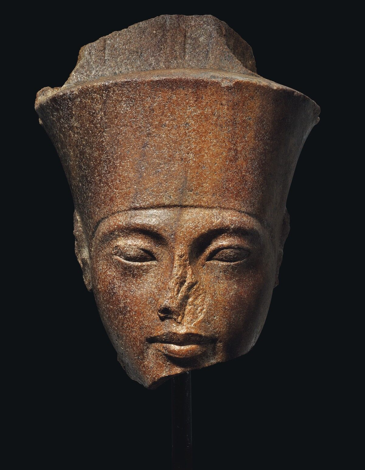 An Egyptian brown quartzite head of the god Amen with the features of pharaoh King Tutankhamun, New Kingdom, 18th Dynasty, reign of Tutankhamun, ca. 1333–1323 B.C.E. Est. above £4 million. Courtesy Christie's.