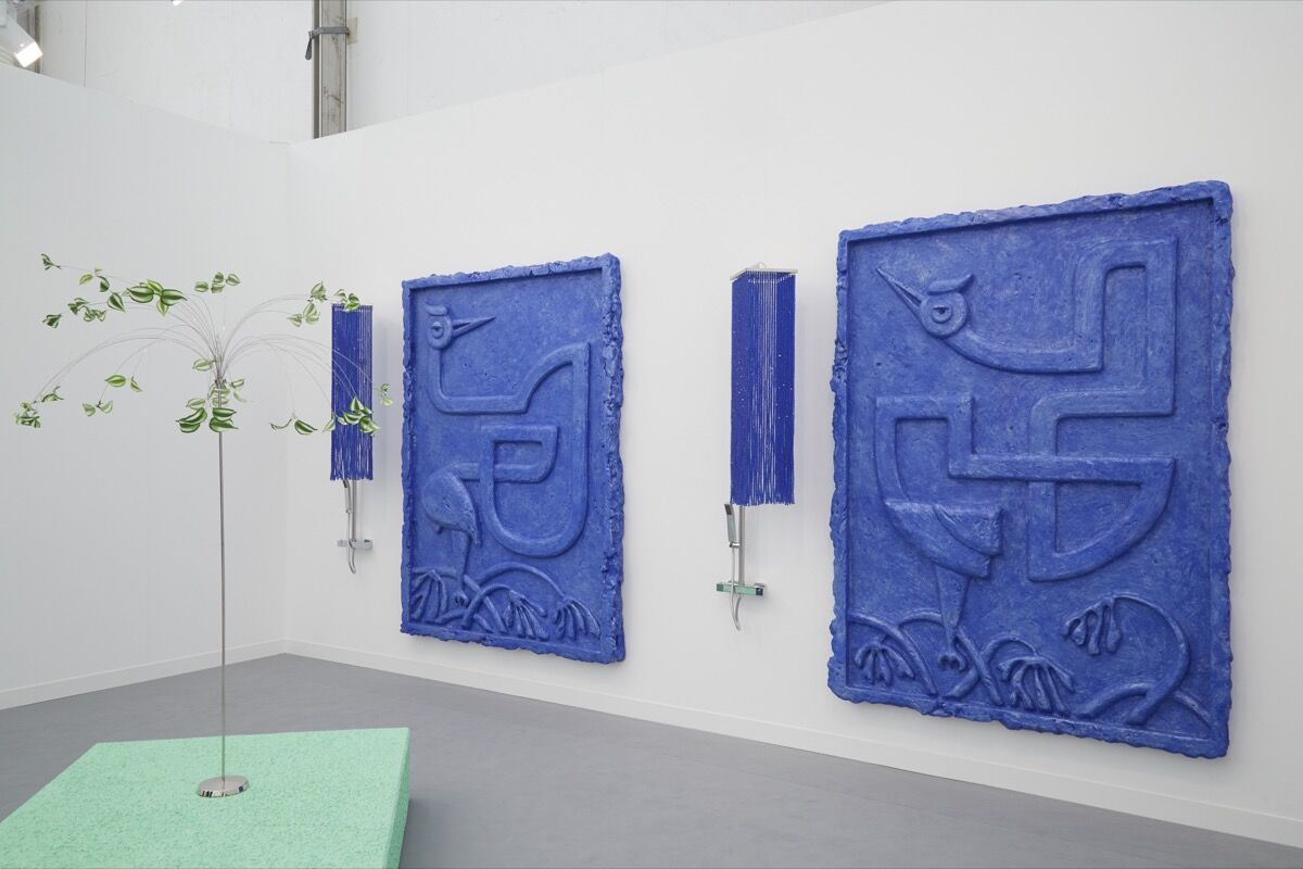 Installation view of works by Yu Honglei at Antenna Space's booth at Frieze London, 2016. Photo by Benjamin Westoby for Artsy.