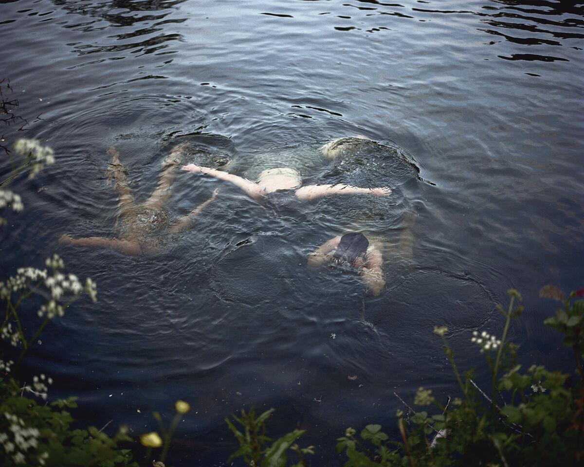 Siân Davey, Girls Swimming at Dusk. Copyright Siân Davey, courtesy of The Michael Hoppen Gallery, London.