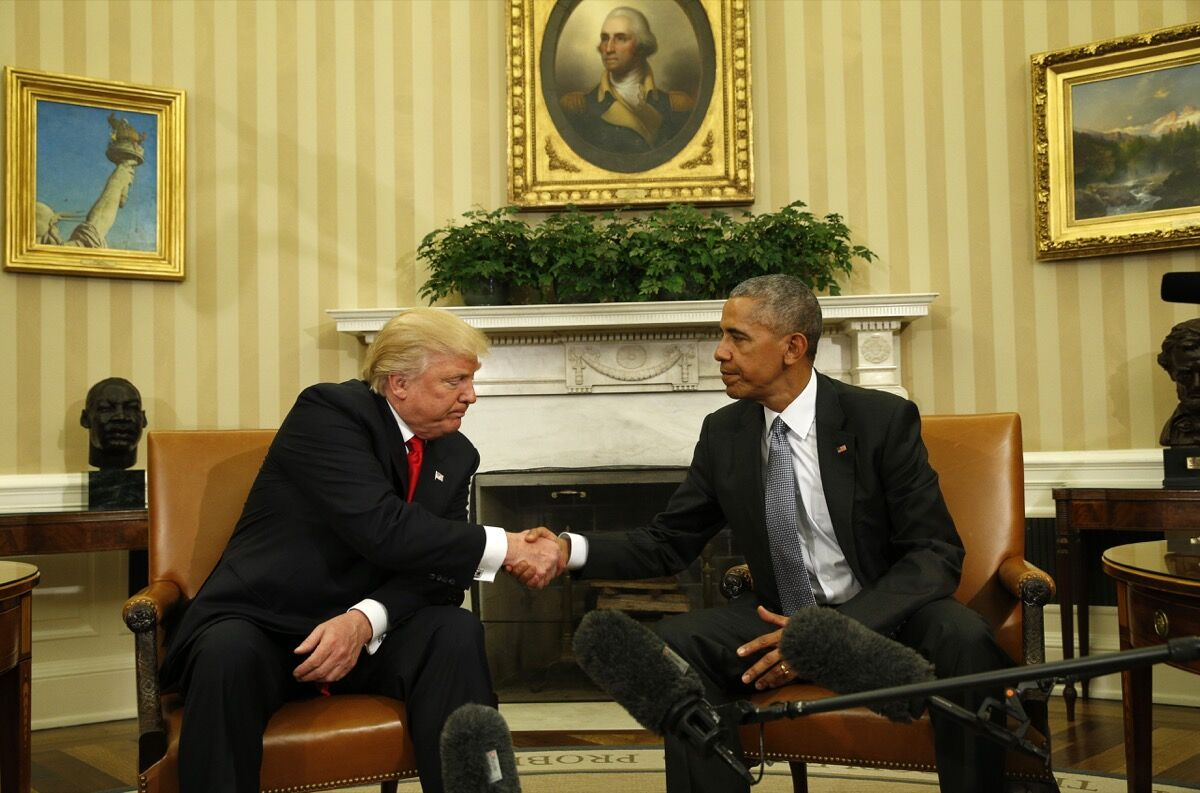 U.S. President Barack Obama (R) greets President-elect Donald Trump in the White House Oval Office in Washington, U.S., November 10, 2016. REUTERS/Kevin Lamarque