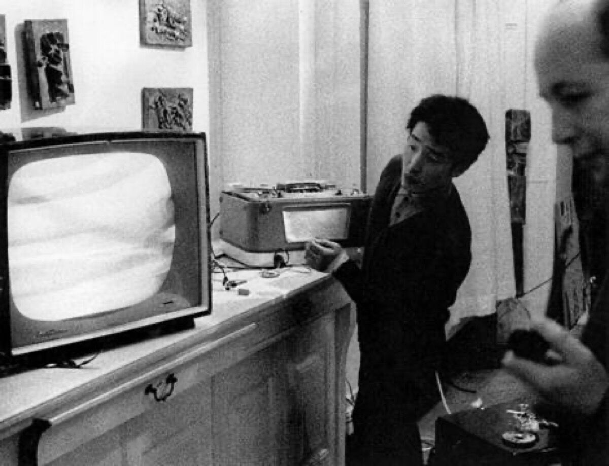 """Nam June Paik installing """"The Exposition of Electronic Music – Electronic Television"""" at Galerie Parnass, Wuppertal, West Germany, 1963. Courtesy of the Nam June Paik Estate."""