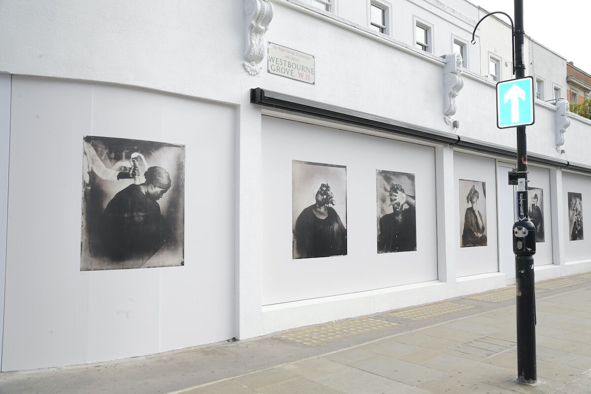 """A street view of the public art exhibition, """"In This Space we Breathe"""" featuring the work of Khadija Saye. Photo by David M. Benett/Getty Images for Eiesha Bharti Pasricha."""