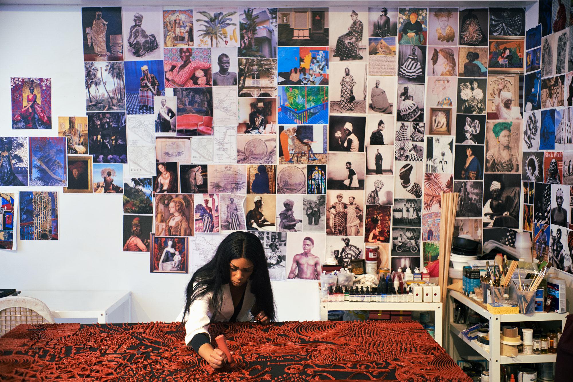 Portrait of Lina Iris Viktor working in her studio in downtown Manhattan. Photo by Alex John Beck for Artsy.