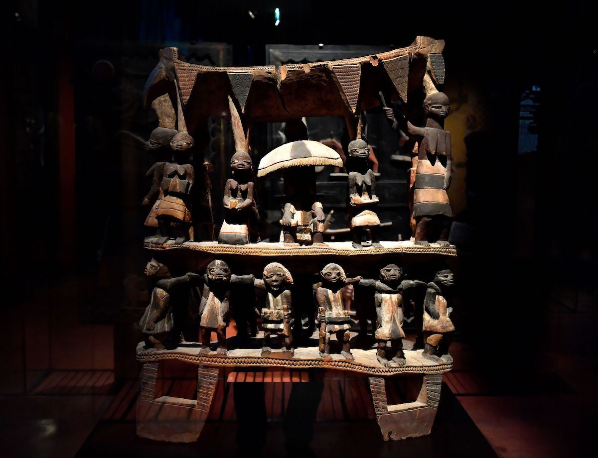 Royal Seat of the Kingdom of Dahomey, from the early 19th century, at the Musée du Quai Branly in Paris. Photo by Gerard Julien/AFP via Getty Images.