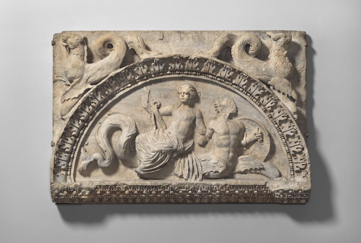 Marble lunette with Nereid riding Triton , 1st quarter of 2nd century A.D., Roman. Courtesy of The Metropolitan Museum of Art.