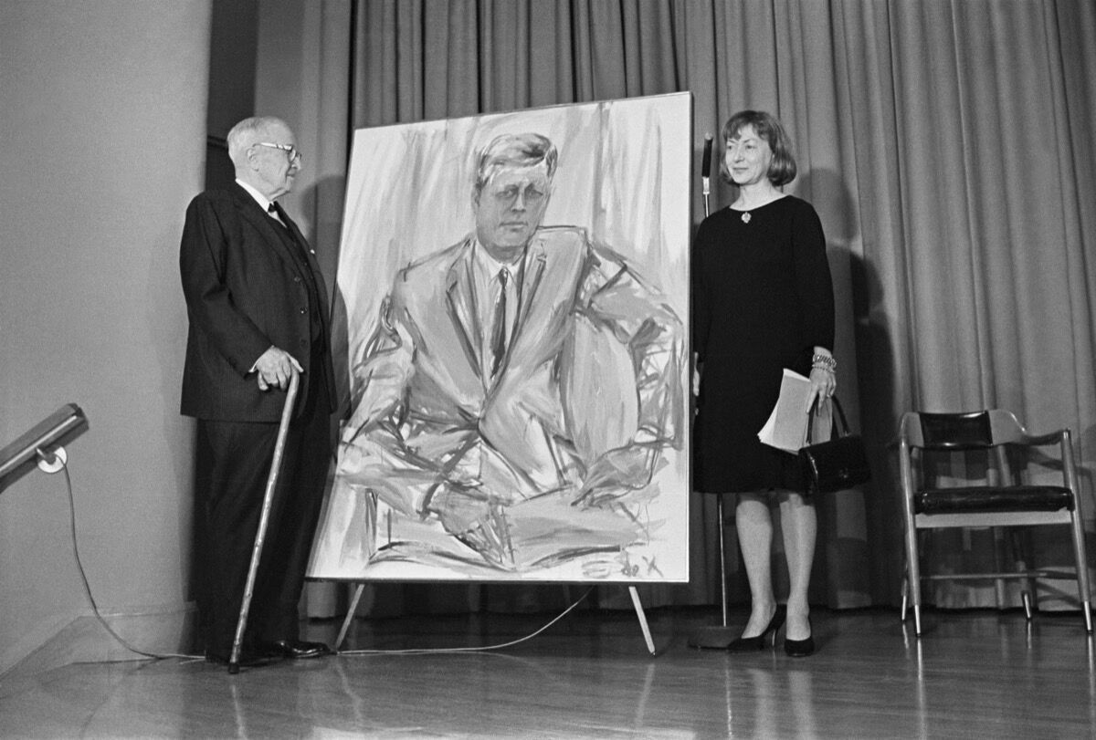Former President Harry S. Truman and Elaine de Kooning stand next to a painting of John F. Kennedy, commissioned for the Truman Library. Photo via Getty Images.