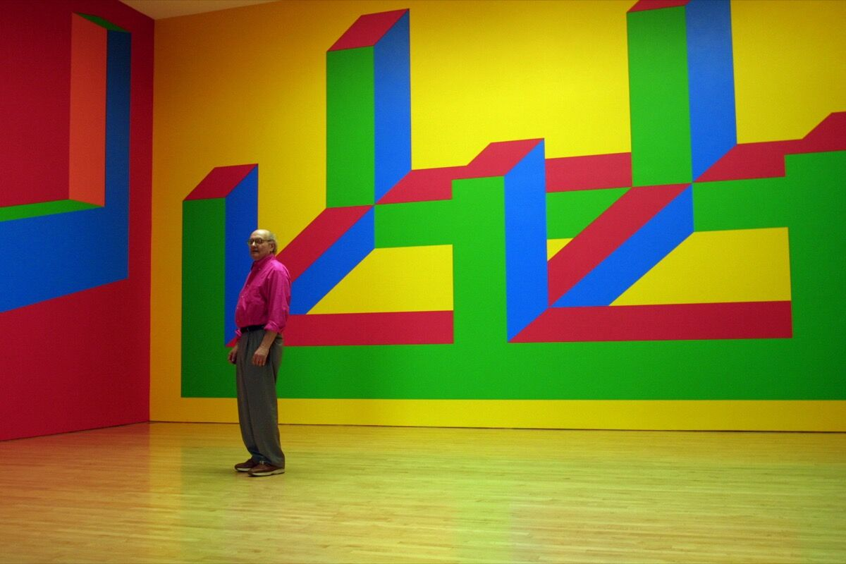 Sol LeWitt dwarfed by his Wall Drawing No. 993, at the Margo Leavin Gallery, Los Angeles. Photo by Gina Ferazzi/Los Angeles Times via Getty Images.