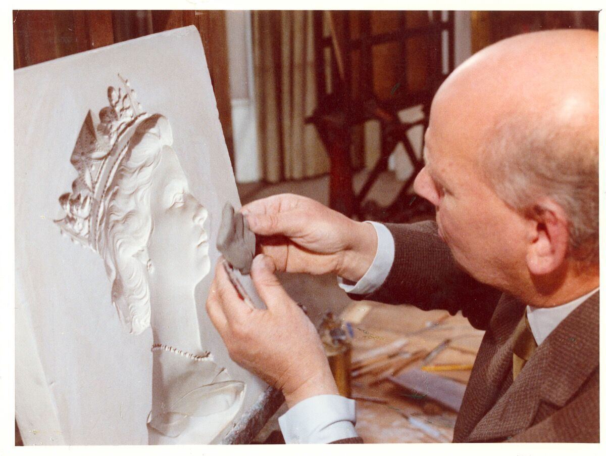Machin taking a clay impression of the plaster cast's head. © Royal Mail, courtesy of The Postal Museum.