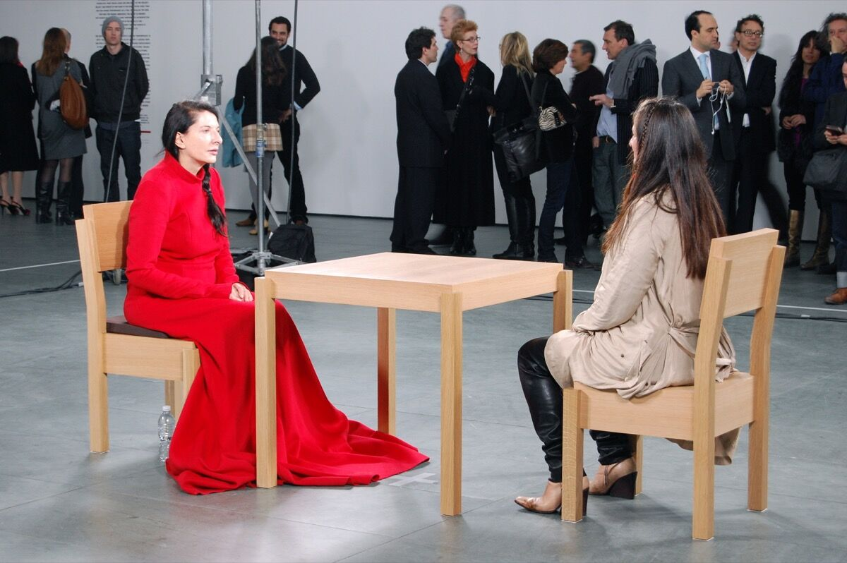 Marina Abramović, The Artist is Present, 2010. Performance, The Museum of Modern Art, New York. Photo by Andrew Russeth, via Flickr.