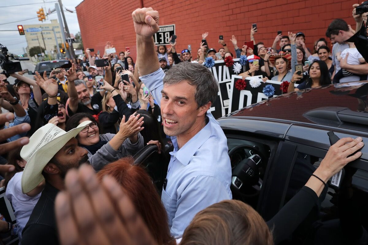 U.S. Senate candidate Rep. Beto O'Rourke pumps his fist for a cheering crowd before departing a campaign rally at the Alamo City Music Hall in San Antonio, Texas on November 4, 2018. Photo by Chip Somodevilla/Getty Image.