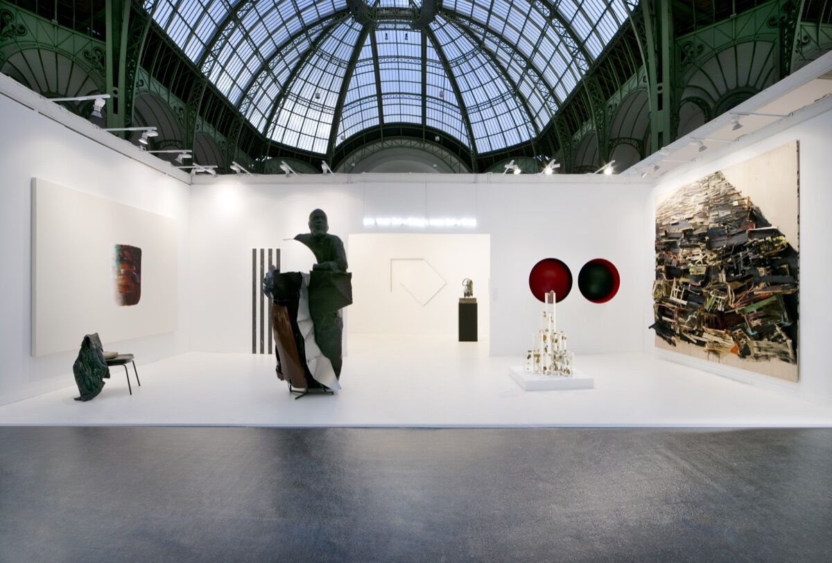 Installation view of Kamel Mennour's booth at FIAC 2019, Paris. © The artists (from left to right) : ADAGP Lee Ufan, ADAGP Tatiana Trouvé, ADAGP Daniel Buren, ADAGP Mohamed Bourouissa, Douglas Gordon / Studio lost but found / VG Bild - Kunst, Bonn 2019 , ADAGP François Morellet, ADAGP Camille Henrot, Alicja Kwade, ADAGP Anish Kapoor, Tadashi Kawamata Photo. Courtesy of the artists, Studio Morellet, and Kamel Mennour, Paris/London.