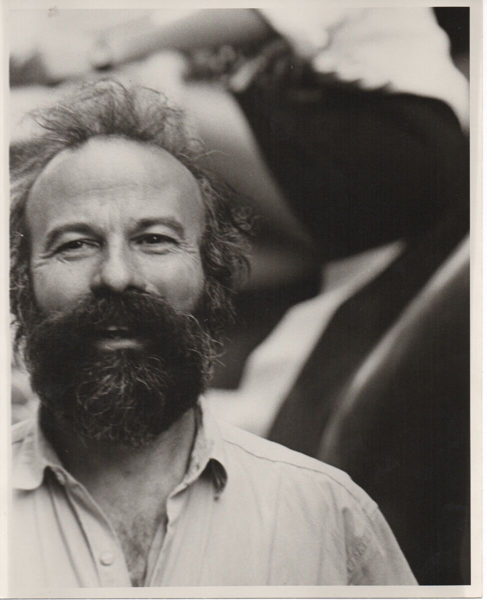 Arturo Di Modica in 1990 after the installation of Charging Bull. Image via Wikimedia Commons.