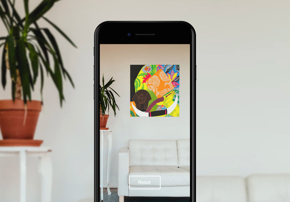Using Artsy's augmented reality feature to place an artwork on a wall.