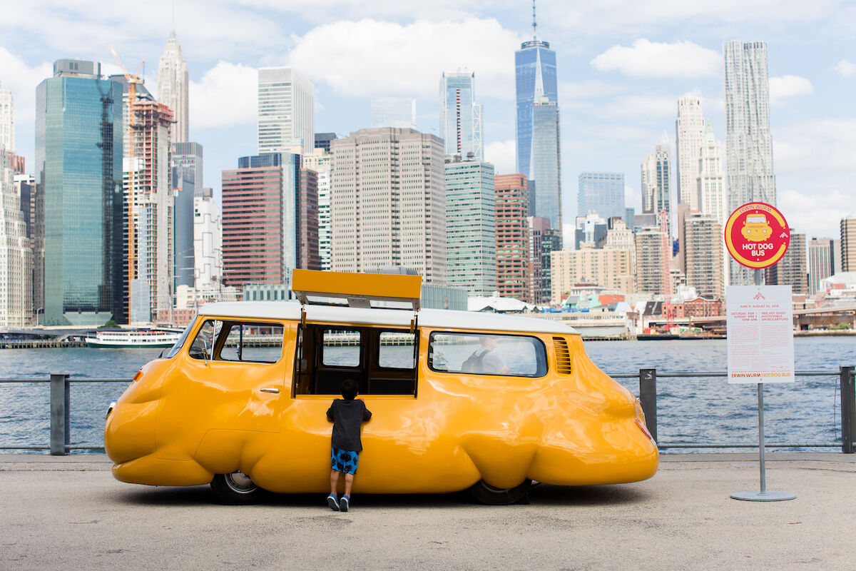 Installation view of Erwin Wurm, Hot Dog Bus, at Brooklyn Bridge Park, 2018. Photo by Liz Ligon. Courtesy Public Art Fund, NY.