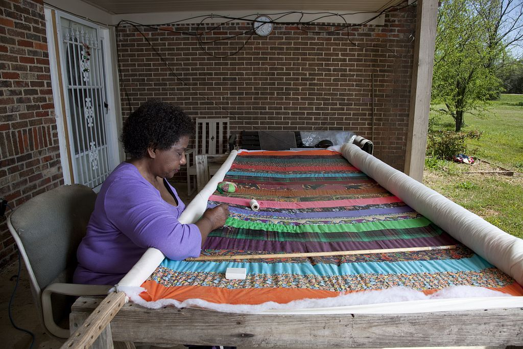 A resident of Gee's Bend sews a quilt, 2010. Photo by Carol M. Highsmith. Courtesy of  the Library of Congress.