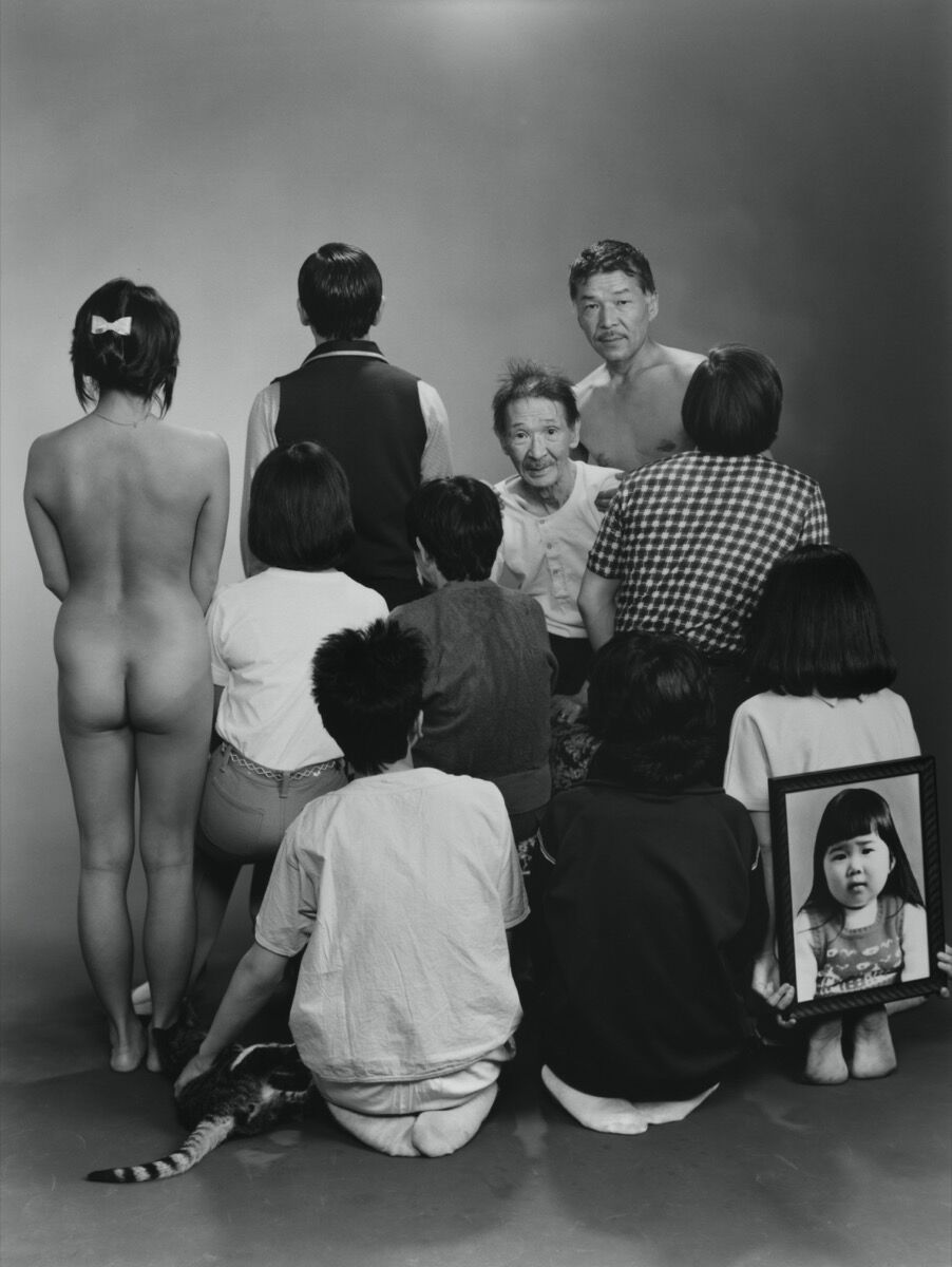 "Masahisa Fukase, Upper row, from left to right: A, a model; Toshiteru, Sukezo, Masahisa. Middle row, from left to right: Akiko, Mitsue, Hisashi Daikoji. Bottom row, from left to right: Gaku, Kyoko, Kanako, and a memorial portrait of Miyako, 1985, from the series ""Family,"" 1971-90 © Masahisa Fukase Archives. Courtesy of Barbican Art Gallery."
