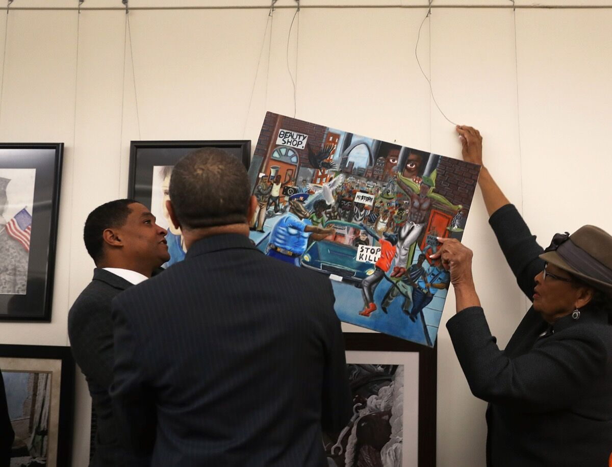 Rep. Cedric Richmond (D-LA), chairman Congressional Black Caucus, Rep. William Lacy Clay (D-MO) and Rep. Alma Adams (D-NC)(L-R) rehang a painting on the U.S. Capitol walls after it was removed by Rep. Duncan Hunter (R-CA) on Friday because he found it offensive on January 10, 2017 in Washington, DC. Photo: Joe Raedle/Getty Images