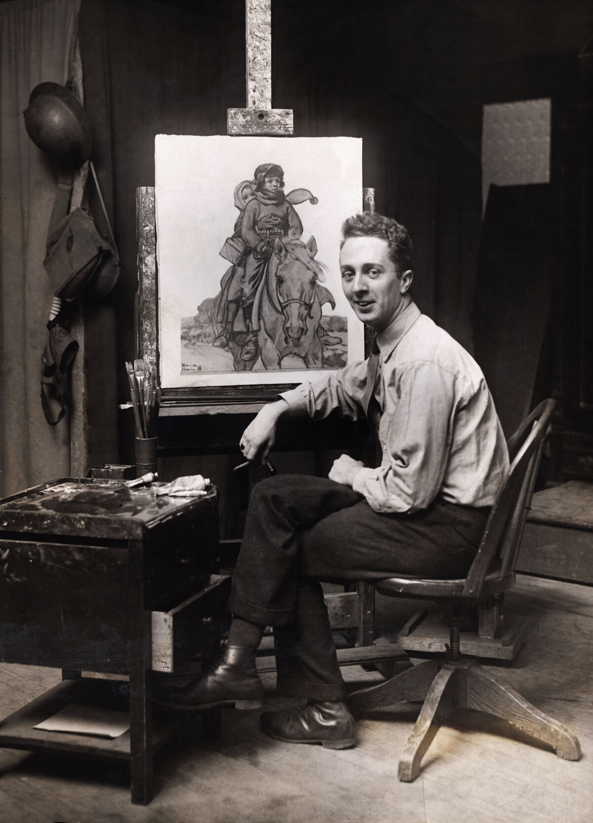 Norman Rockwell painting at his easel. Photo by George Rinhart/Corbis via Getty Images.