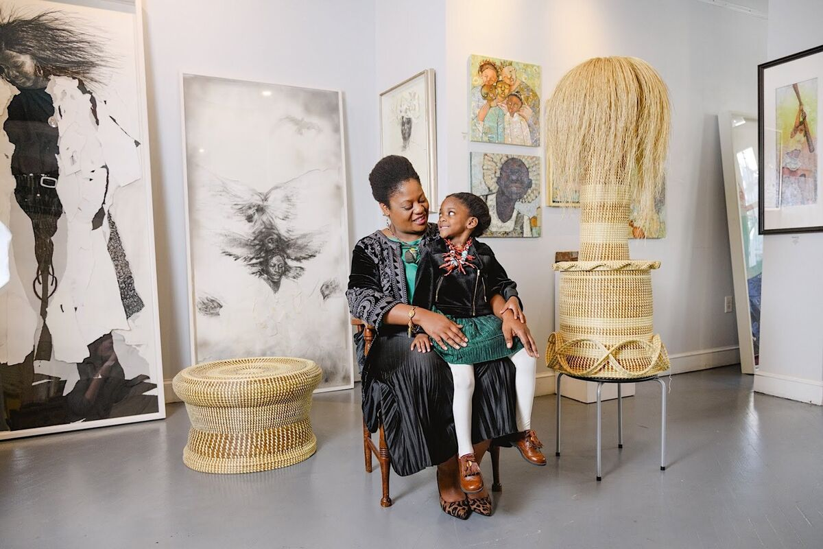 Portrait of Meisha Johnson, owner of Neema Gallery, with her daughter. Photo by Ruta Smith. Courtesy of Neema Gallery.