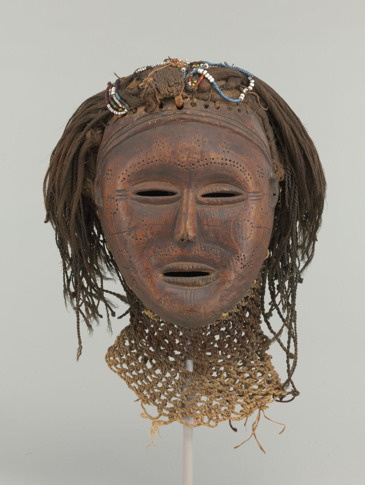 Unidentified artist from the Lwena region, Angol, Mask (Mwana wa Pwevo), early 20th century. Courtesy of The Baltimore Museum of Art.