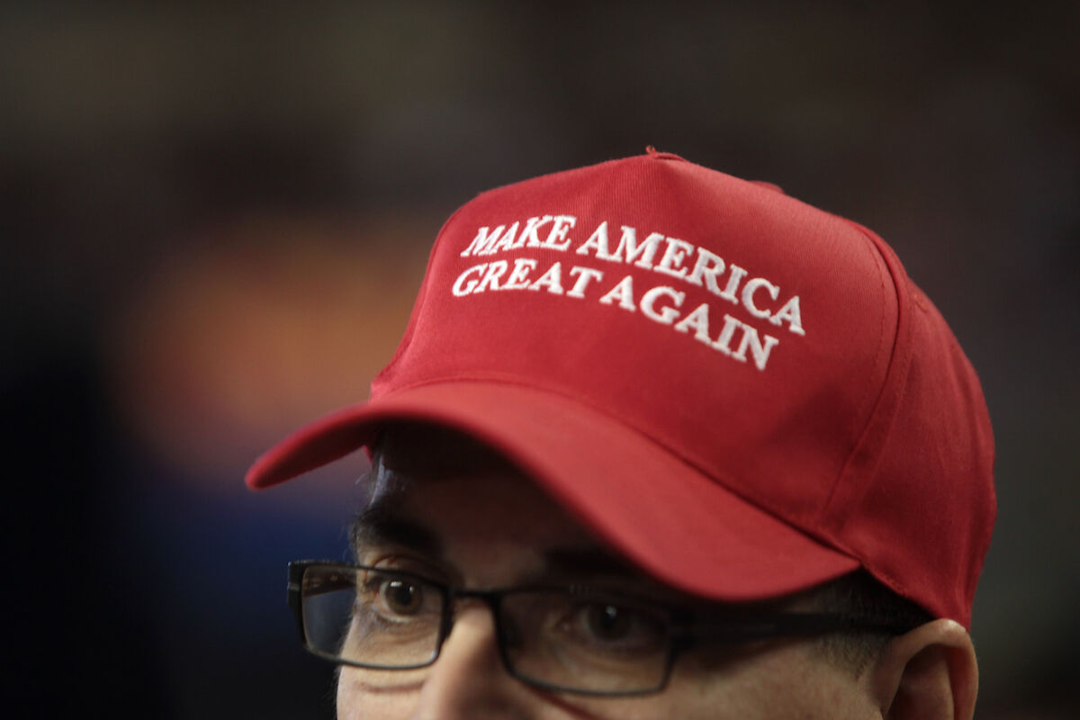 "A man wearing a ""Make America Great Again"" at a Trump rally in 2016. Photo by Gage Skidmore, via Wikimedia Commons."