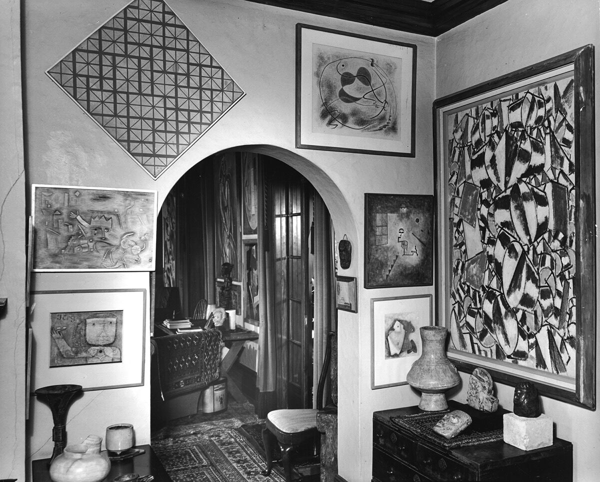 Dining room with a view into the living room through the north archway, ca.1944. Photo by Fred R. Dapprich. Courtesy of Philadelphia Museum of Art, Library and Archives, Arensberg Archives. Pictured artworks: Paul Klee, Animal Terror, 1926, Jörg, 1924, and Prestidigitator (Conjuring Trick), 1927. © 2020 Artists Rights Society (ARS), New York; Fernand Léger, Contrast of Forms, 1913–14. © 2020 Artists Rights Society (ARS), New York / ADAGP, Paris; André Masson, Animal Caught in a Trap, 1929. © 2020 Artists Rights Society (ARS), New York / ADAGP, Paris.