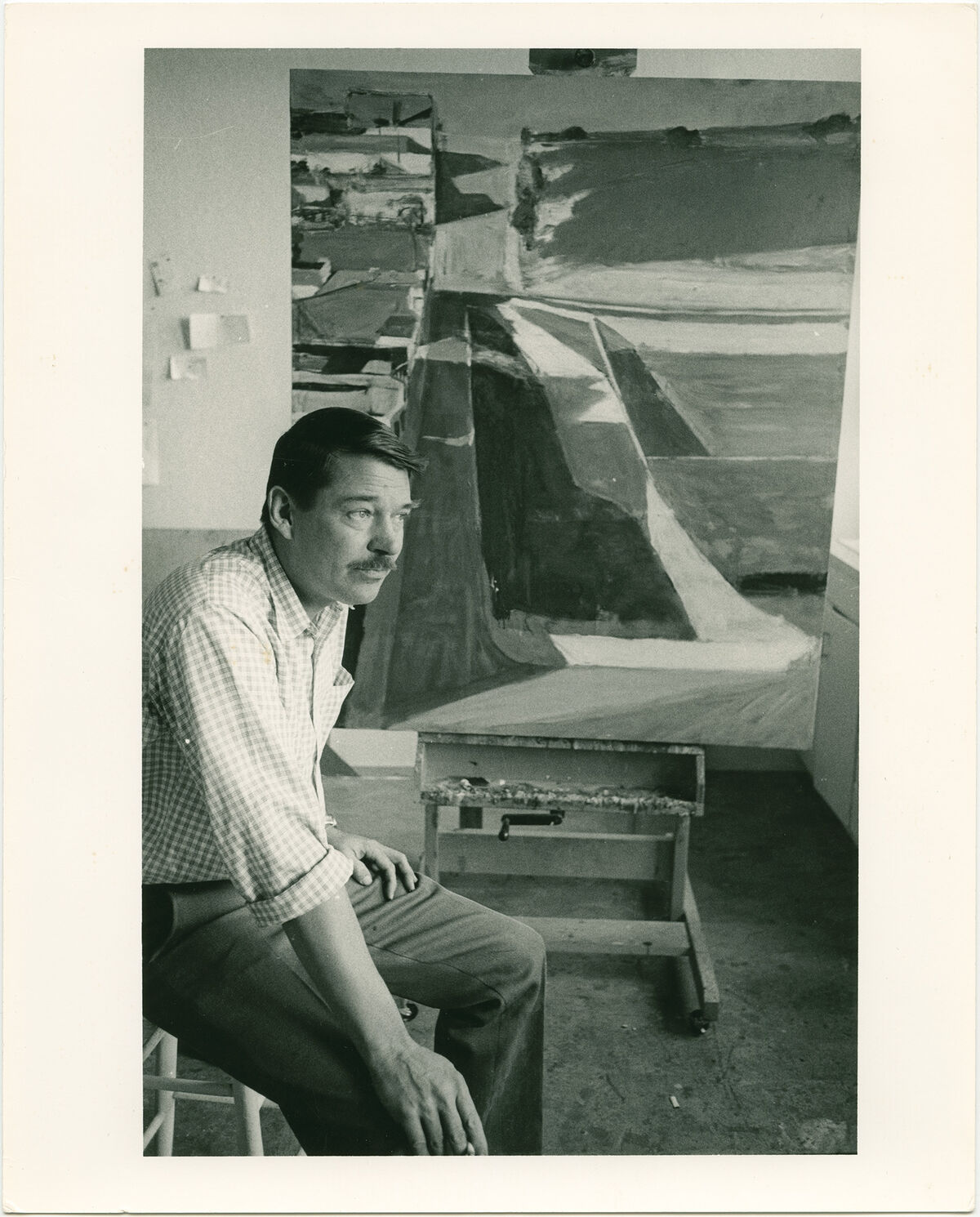 Richard Diebenkorn with his painting Cityscape #1 , in his studio at Stanford University, 1963. Photograph by Leo Holub. Courtesy of The Richard Diebenkorn Foundation.