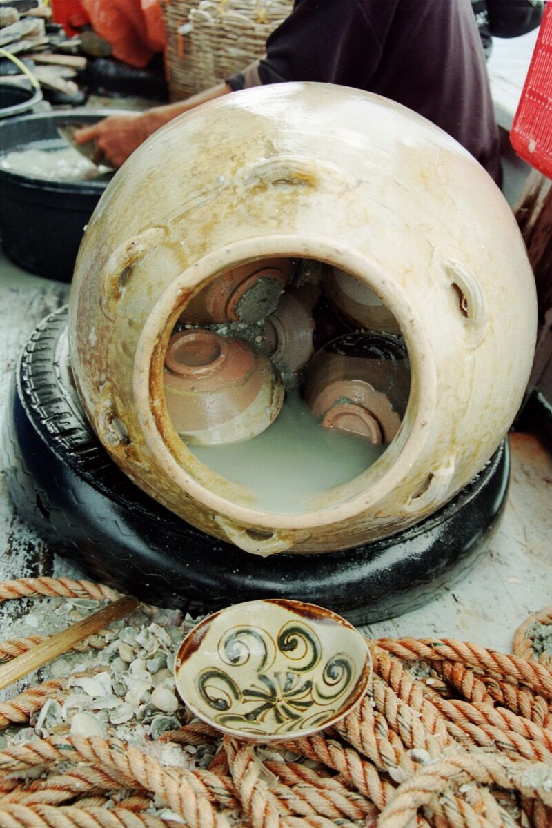 Changsha bowls tightly packed inside a storage jar. Photo by Michael Flecker. Courtesy of Asia Society Museum.