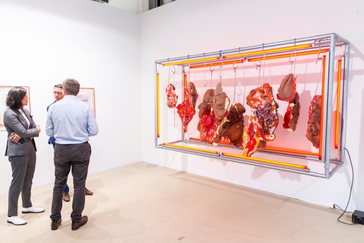 Installation view of Doreen Garner's Red Rack of those Ravaged and Unconsenting (2018) at JTT Gallery's booth at Art Basel in Basel, 2018. © Art Basel.