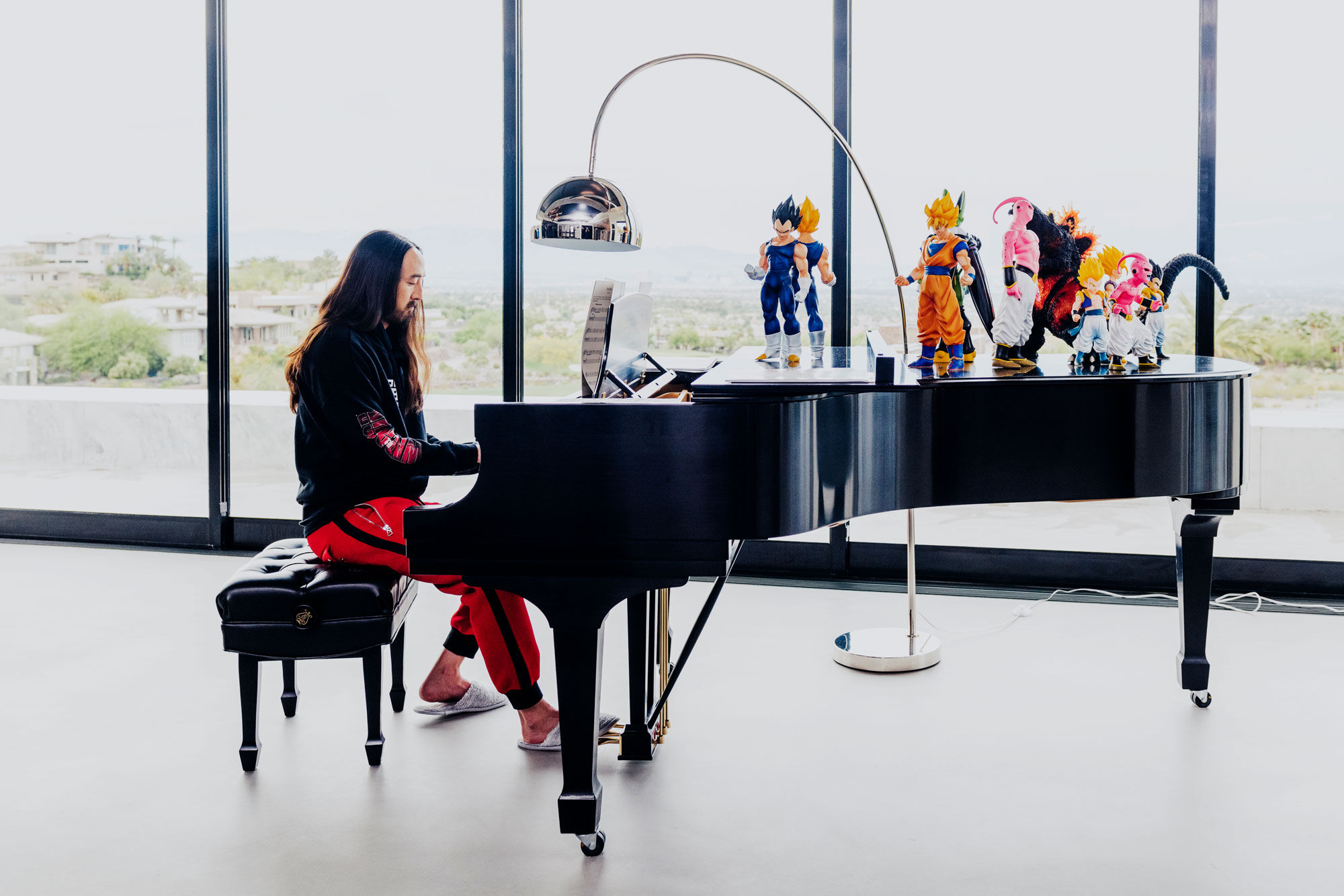 "Aoki keeps his Dragon Ball Z toys on his piano in his house overlooking Las Vegas. ""This house is a good example of what my brain is,"" he says. Photo by Brian Guido for Artsy."