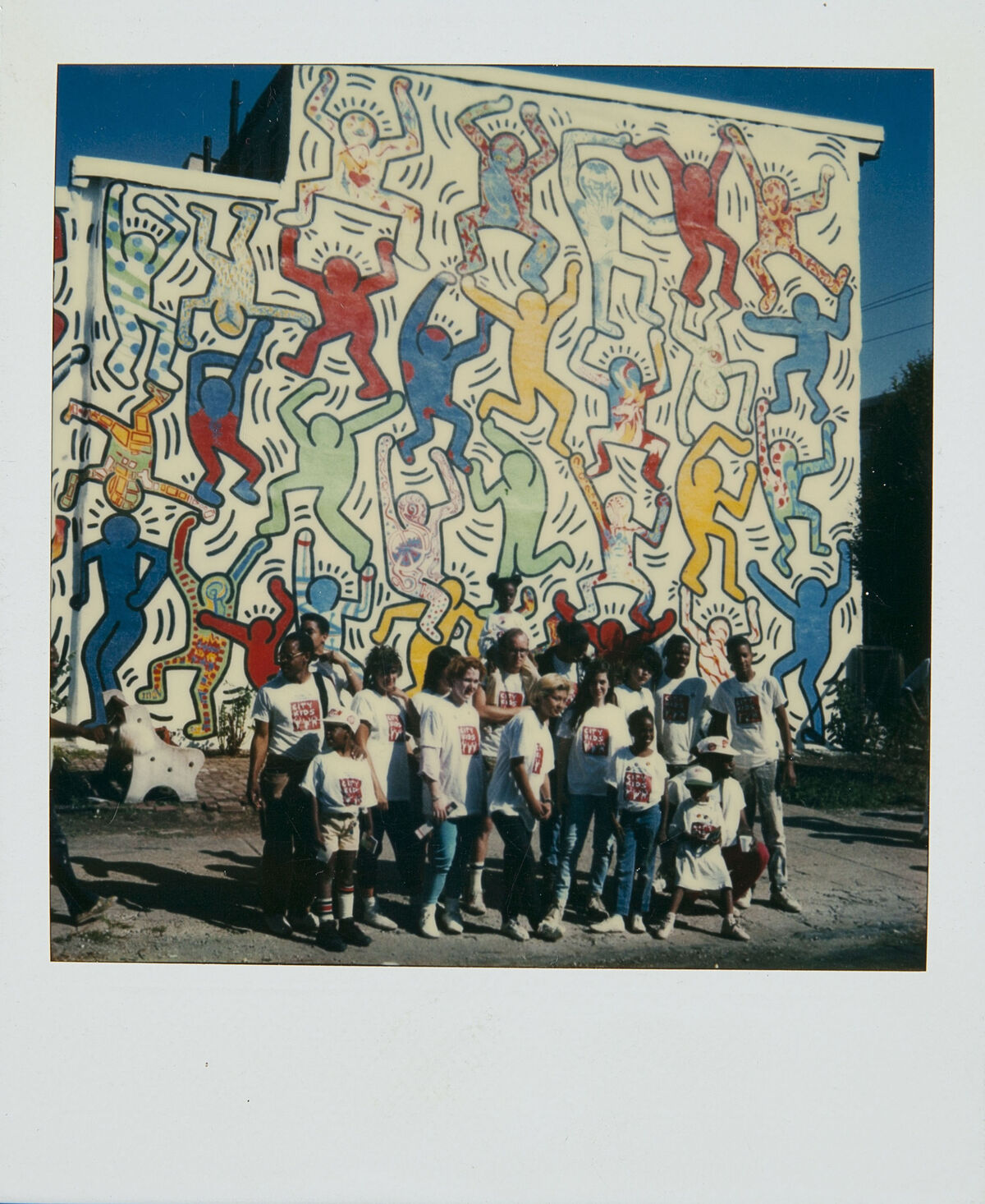 Polaroid and mural by Keith Haring, We the Youth, Philadelphia Mural, 1987. Courtesy of The Keith Haring Foundation Archives.