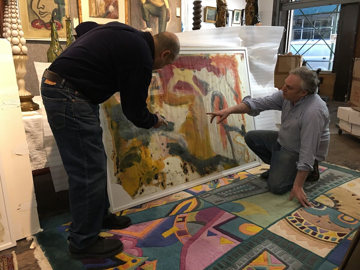 Lawrence Castagna (left) and David Killen examine a painting believed to be by Willem de Kooning. Photo courtesy David Killen Gallery.
