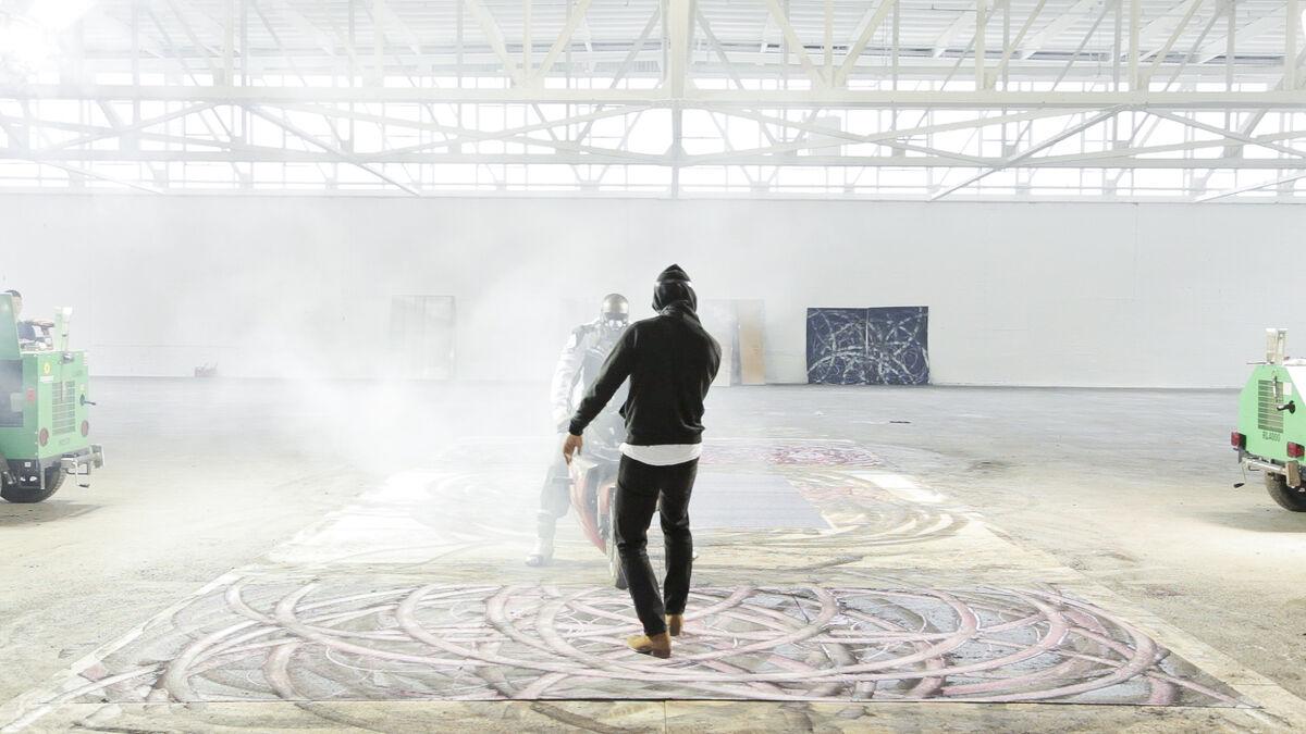 Mana studio artist Aaron Young creates artwork using motorcycles in Mana Glass Gallery, November 2013. Photo by E. Lee Smith.Courtesy Mana Contemporary.