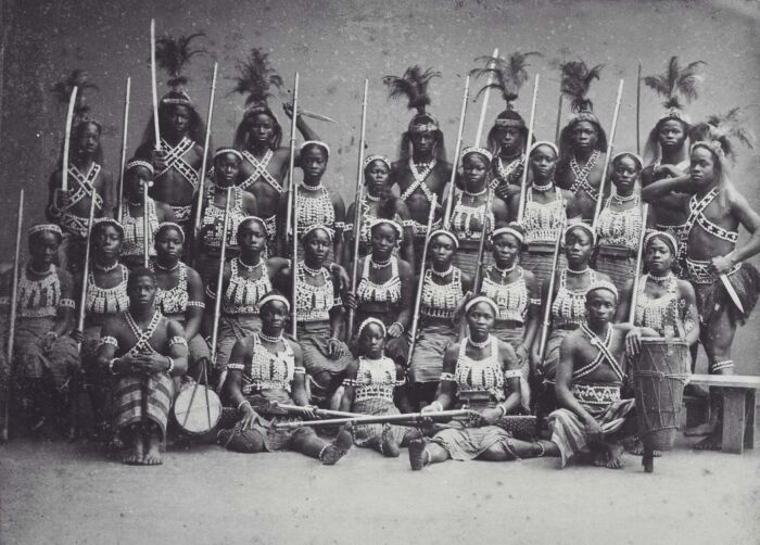 """Group portrait of the """"Amazons of Dahomey"""" during their stay in Paris. Image via Wikimedia Commons."""